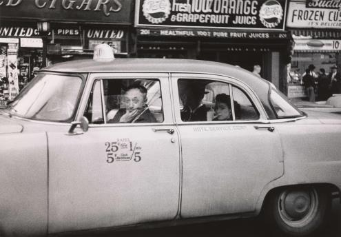 Diane Arbus (1923-1971).  Taxicab driver at the wheel with two passengers, N.Y.C.  1956 © The Estate of Diane Arbus, LLC.  All Rights Reserved