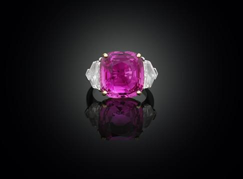 "17.61 carat Ceylon pink sapphire and diamond ring is set in platinum and 18K yellow gold which brings out the ""bubblegum"" color of the center stone."