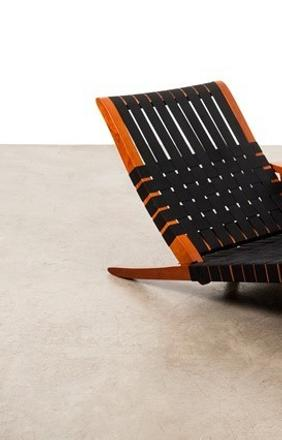 George Nakashima (1905-1990) Long chair, 1947.  Walnut and textile, €60,000-80,000.
