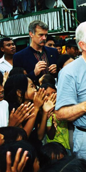 Former U.S.  President Jimmy Carter and former First Lady Rosalynn Carter shaking hands with children during the Indonesian elections June 5-9, 1999.