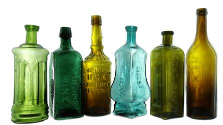 American Bottle Auctions' Auction #67 will feature the Ken Fee collection of mostly Western bitters bottles, to include a rare blue Cassin's Grape Brandy Bitters bottle (fourth from left).