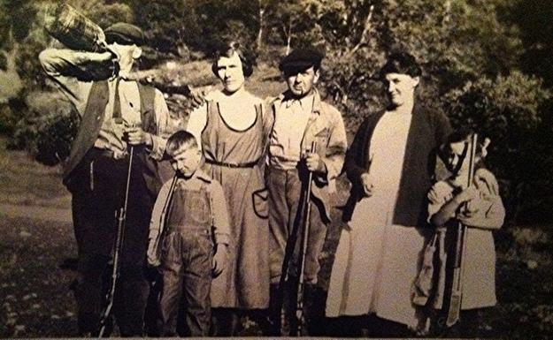 Sam Kerbey, pioneer gun collector, center, and Russell Kerbey, who inherited the gun collection, as a young boy, far left.
