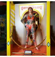 """Custom sculpted, 68-inch-tall character portraying Krystyne Kolorful – who had 95 percent of her body surface tattooed, with a """"Most Tattooed Lady"""" PVC sign (est.  $1,000-$2,000)."""
