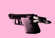 Laurie Simmons, Lying Gun/Pink, 2014.  Pigment Print, 20 5/8 x 30 inches.  Edition of 10, each in a unique color.