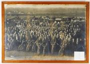 Large group photo taken around 1911 of Henry Street Garage telephone linemen, some shown seated on motorcycles, cars and horse-drawn carriages ($2,000).