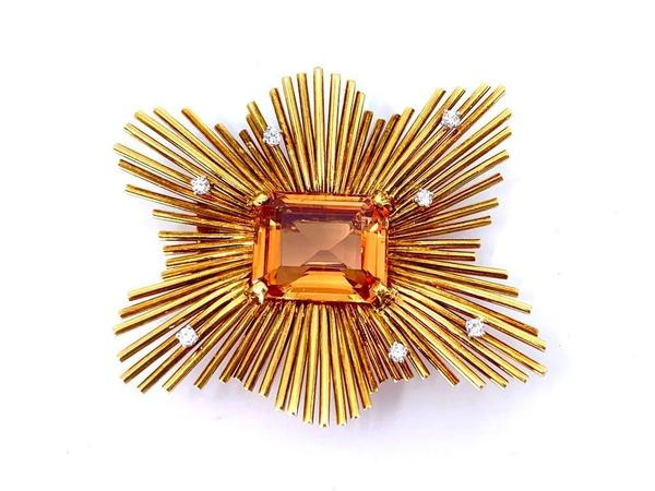 Custom-made 18kt yellow gold, imperial topaz and diamond brooch of sunburst form, with undulating golden rods set with seven brilliant cut diamonds (est.  $12,000-$15,000).