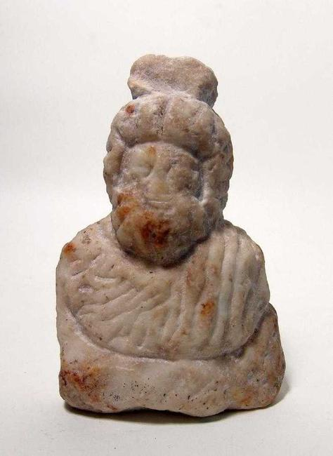 Roman marble bust of the popular deity Serapis from the 1st-3rd Century AD, robed with a heavy beard, a modius atop his head, standing a little more than 6 inches tall (est.  $1,500-$2,500).