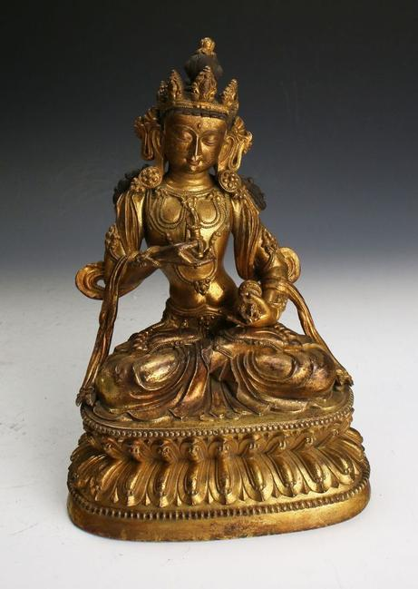 Antique Chinese Ming Dynasty gilt bronze Buddha, beautiful and diminutive at 9 inches tall by 6 inches wide (est.  $2,500-$5,000).