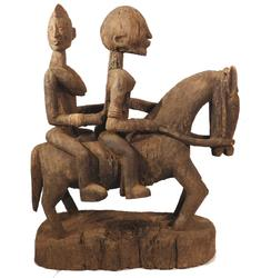 Equestrian sculpture from the Dogon People of Mali, showing a horse with two riders (one male and one female), carved from hardwood in the 19th century (est.  $20,000-$50,000).