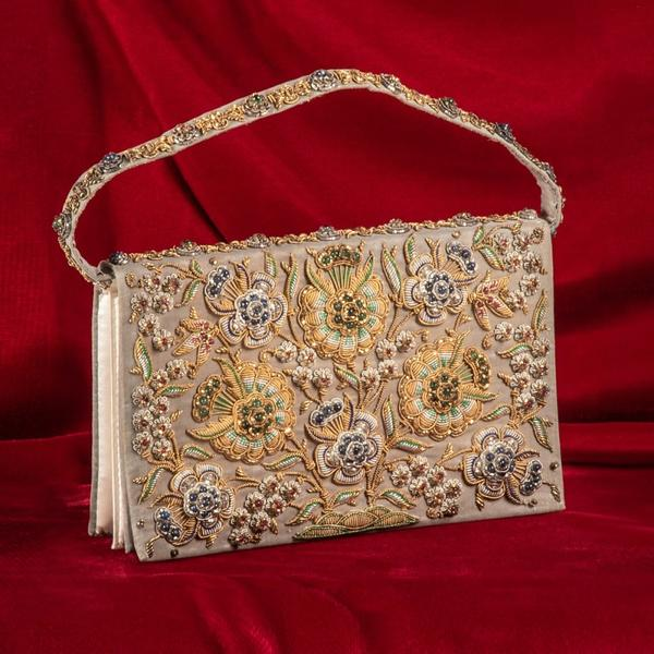 Precious gem beaded evening purse encrusted with 118 rubies, 106 sapphires and 72 emeralds, having gold and silver foil wrapped thread (est.  $2,000-$4,000).