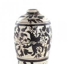 Beautiful Cizhou ware meiping vase from northern China and made during the Song-Jin dynasty, with a slip-decorated foliate design, 17 inches tall (est.  $10,000-$15,000).