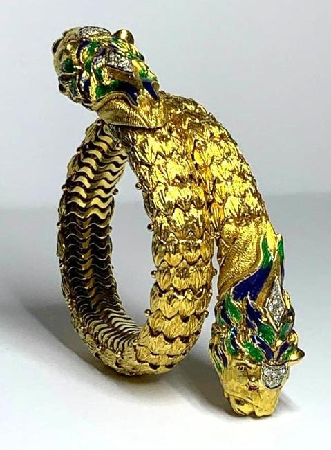 Gorgeous 18kt Italian yellow gold and enamel double-headed lion flexible bracelet with ten small round accent diamonds, the lions having small ruby eyes (est.  $6,000-$8,000).