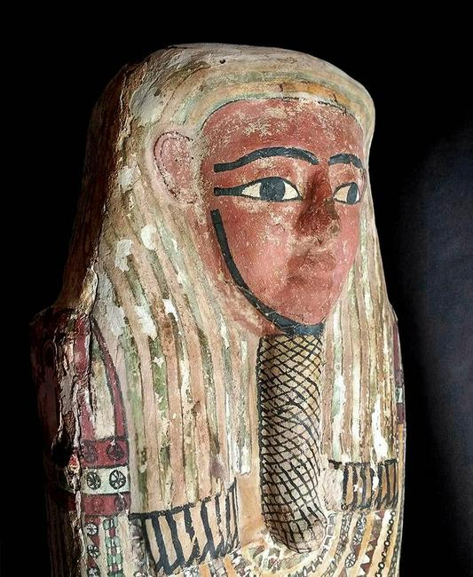 Egyptian polychrome gesso coffin lid, 26th to 31st Dynasty, circa 664-332 BCE, 74in long.  Depiction of a serene countenance atop a densely decorated body.  Estimate $100,000-$150,000