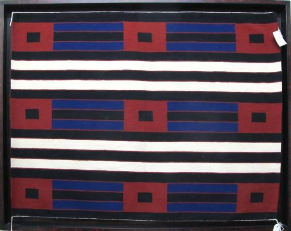 Second Phase Navajo chief's blanket, made by Navajo weaver Albert Jackson, near Cove, Arizona, circa 1850s, framed (est.  $10,000-$20,000).