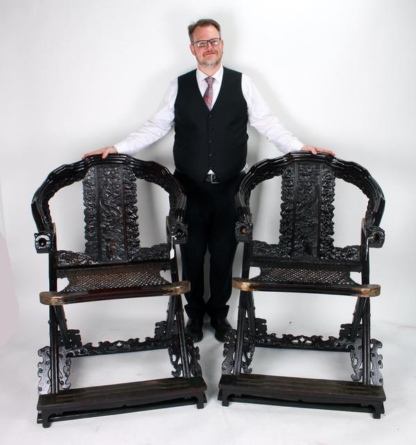 An expected top lot is this pair of elaborate zitan folding chairs with dragon arms, heavily carved legs, arm rests and back, all in a dragon and cloud motif (est.  $3,000-$5,000).