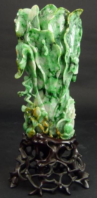 This Chinese late Qing Dynasty carved jadeite cabbage vase, not quite 7 inches tall, sold for $59,520 at Elite Decorative Arts' April 11th auction in Florida.