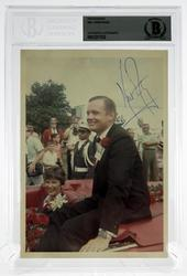 Signed photograph of Neil Armstrong, 5 inches by 7 inches, authenticated and encapsulated by Beckett Authentication Services (est.  $400-$500).