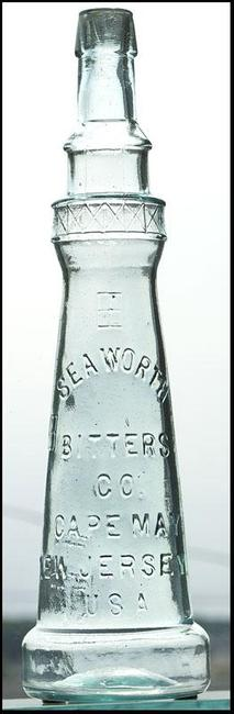 Seaworth Bitters Company bottle, made circa 1880-1890 in a unique form, almost identical to the Cape May Lighthouse in New Jersey, aqua colored and in perfect condition ($25,740).