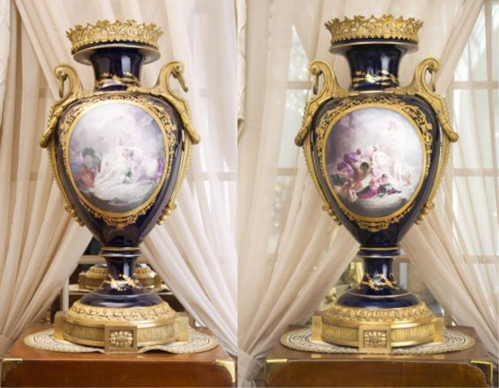 Pair of 19th century Sevres vases, each one 35 inches tall, ormolu mounted cobalt ground porcelain with two handles on each side (est.  $15,000-$25,000).