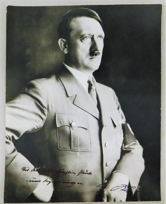 Photo of German leader Adolph Hitler, signed by him with a sentiment, circa 1933-1939, taken by Heinrich Hoffman, Hitler's official photographer ($1,750).