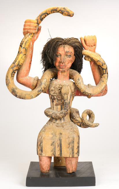 Fine Old African Mami Wata Figure.  Carved and paint decorated wood with raffia.  Collection of Allan Stone, New York.  Size: 30.5'' x 19'' x 8.5'' (77 x 48 x 22 cm).