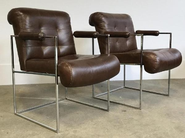 A pair of Milo Baughman for Thayer Coggin Thin Line chrome armchairs was designed in a dark brown vinyl upholstery mimicking leather, 32 by 23 by 29 inches ($300-600).