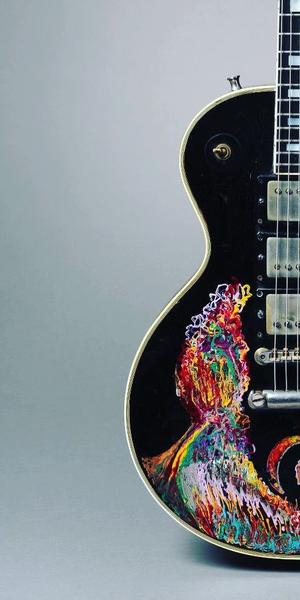 Gibson Guitar Corp.  (Kalamazoo, MI); painted by Keith Richards.  Les Paul Custom electric guitar (serial no.  7 7277), 1957; painted 1968.  Carved mahogany body and neck, ebony fingerboard, 24 3/4 in.  scale; black finish with hand-painted design; three patent-applied-for (PAF) humbucking pickups, three-way selector switch, two volume and two tone controls.  Collection of Keith Richards