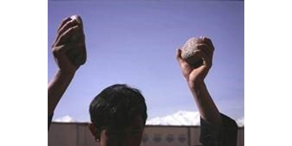 Lida Abdul (b.  1973, Kabul, Afghanistan; lives and works in Kabul and Los Angeles); still of Clapping With Stones; 2005; 16 mm film transferred to DVD; 5 min.; image courtesy of the artist and Giorgio Persano Gallery