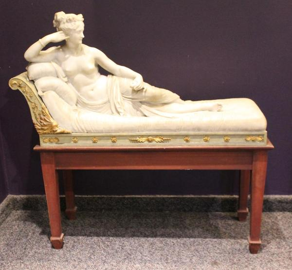 Carved marble sculpture of Pauline Bonaparte as Venus Victrix, from the 19th or 20th century after Antonio Canova (Italian, 1757-1822) on a custom-built wood stand (minimum bid: $3,500).