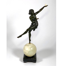 Art Deco bronze sculpture by Marcel Andre Bouraine (French, 1886-1948), titled The Juggler (1925), depicting a woman juggling as she balances on an onyx sphere (est.  $2,000-$4,000).