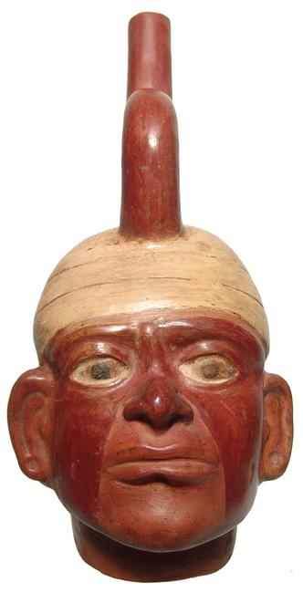 Lovely Moche portrait vessel made between 100 BC and 500 AD, 11 ½ inches tall, depicting a male with well-modeled features and a wrapped headdress (est.  $600-$800).