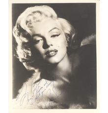"""Signed and inscribed portrait photograph of Marilyn Monroe, inscribed to """"Bob"""" (likely Robert Mitchum, Monroe's co-star in the 1953 film River of No Return) (est.  $12,000-$14,000)."""