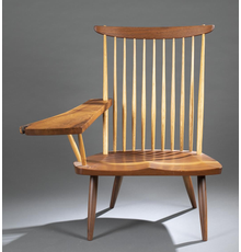 Nakashima lounge chair with free right arm, hickory spindles and a sap walnut seat, signed and dated (2000) beneath the seat, estimate $4,000-$6,000.