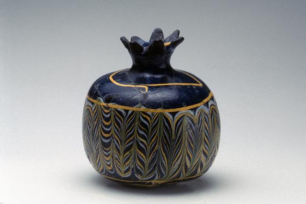 Newark Museum.  Pomegranate shaped vessel.  Egypt, 12th century BCE.  Core-formed glass.  3 ¾ in.  x 3 ¾ in.