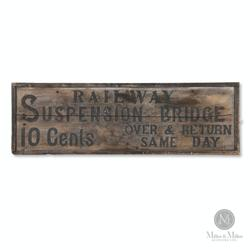"Niagara Falls Railway Suspension Bridge wood sign, 1880s (""travel over and back for 10 cents""), historically significant and 16 inches by 50 ½ inches (est.  $2,500-$4,000)."