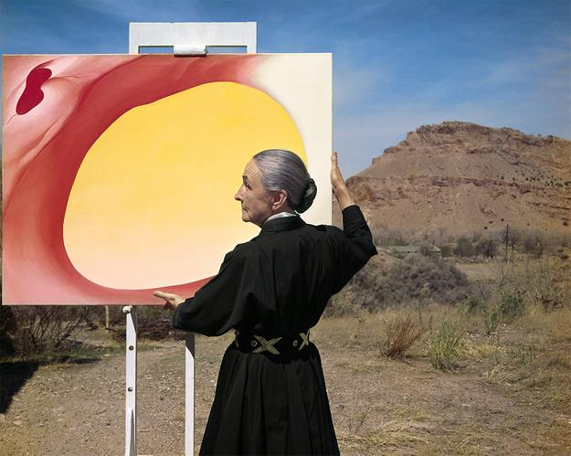 "Tony Vaccaro, Georgia O'Keeffe with ""Pelvis Series, Red with Yellow"" and the desert, 1960.  Georgia O'Keeffe Museum.  Courtesy of Tony Vaccaro studio."