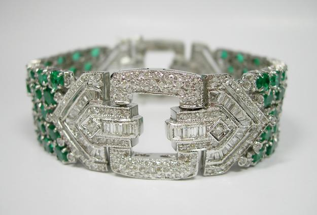 From Lorraine Wambold Estate Jewelry is an Emerald Buckle Bracelet.
