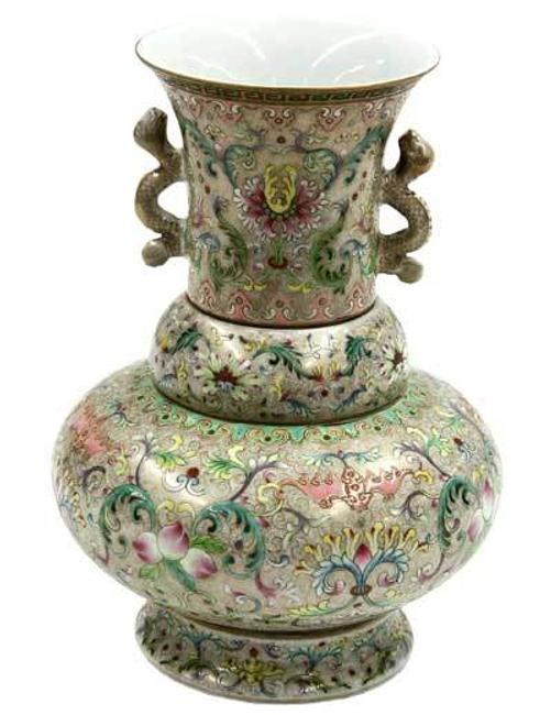 This Chinese multiple section vasiform porcelain container was estimated to bring $300 - $500, but sold for $27,255.