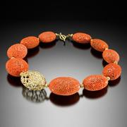 "Mediterranean Decay Coral Necklace"" by Barbara Heinrich of coral, perforated at the bottom of the ocean, along with an 18k gold egg-shaped bead that mimics the coral and a hand fabricated gold toggle clasp.  Pittsford, N.Y."