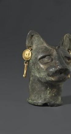 (left to right): Cat's Head, Egypt, Roman Period, 30 B.C.E.–3rd century C.E., bronze and gold, Brooklyn Museum, Charles Edwin Wilbour Fund, 36.114; Sphinx of King Sheshenq, Egypt, Third Intermediate Period, Dynasty 22–Dynasty 23, c.  945–718 B.C.E., bronze, Brooklyn Museum, Charles Edwin Wilbour Fund, 33.586; Standing Lion-Headed Goddess, Egypt, Late Period or later, 664–30 B.C.E., faience, Brooklyn Museum, Charles Edwin Wilbour Fund, 37.943E