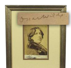 "Sepia tone bust portrait photograph of Irish author Oscar Wilde (1854-1900), in an overcoat with a wide fur collar, signed as ""Oscar Wilde"" and dated ""Jany.  23 '82"" (est.  $6,000-$7,000)."