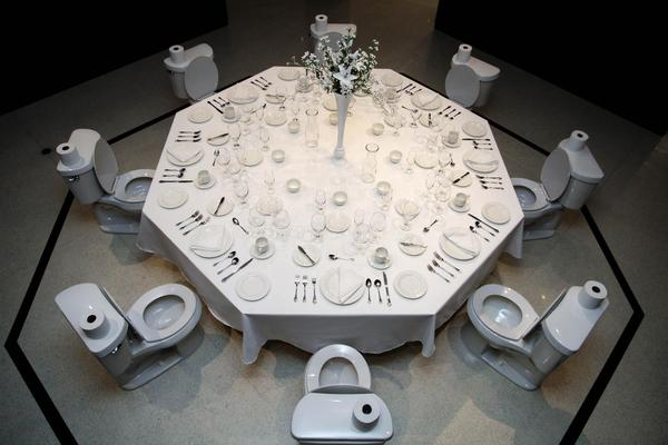 "Paul Ruscha (U.S.  b.  1942) Dinner for Donald, 2020; Table, toilet, and place settings; 156"" diameter; Loan courtesy of the artist."