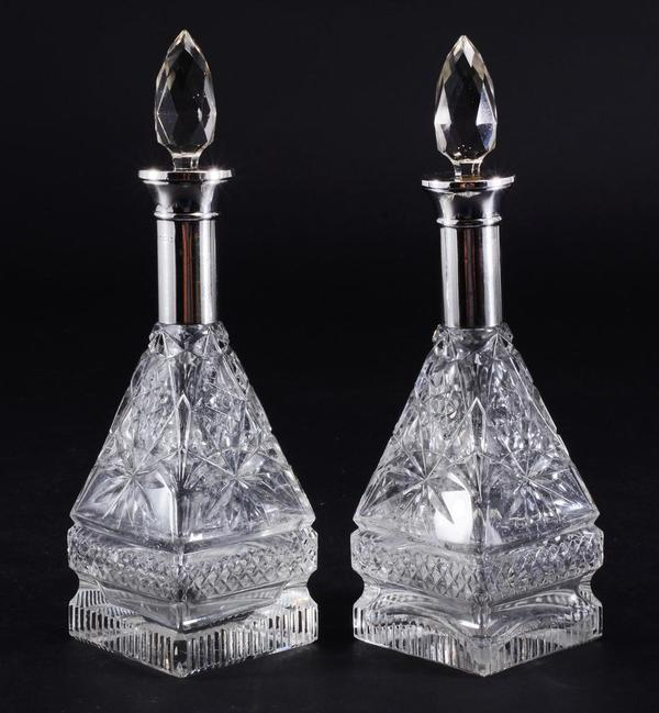 Pair of silver neck perfume bottles.