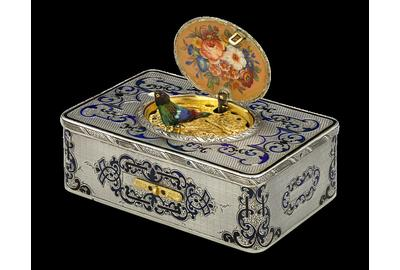 Frères Rochat crafted this rare, early Swiss singing bird box with the desirable fusée movement, housed in an elegant engraved silver and hand-enameled case.  Circa 1840.