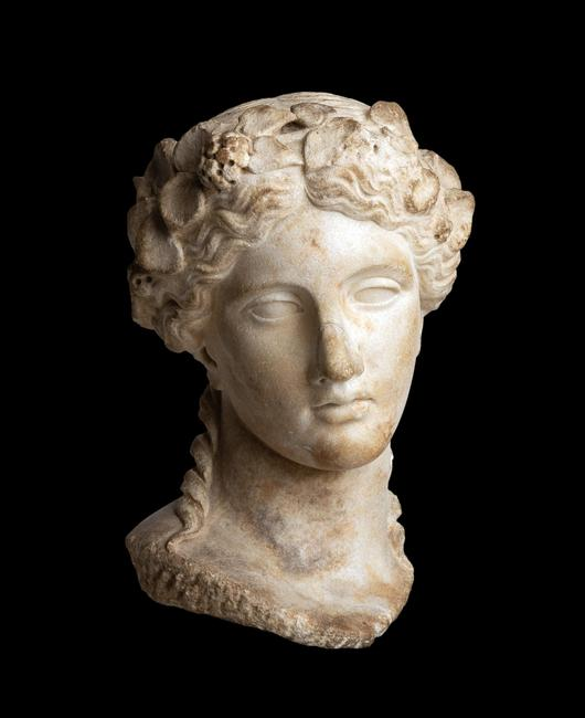 Life-size Roman marble head of Dionysos, after an early 4th century BC late Classical Greek archetype, dating to the Roman Imperial, Hadrianic period (est.  $50,000-$80,000).
