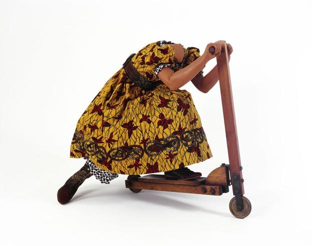 Yinka Shonibare, MBE (Nigerian, b.  1962).  Girl on Scooter, 2009.  Mannequin, Dutch wax printed cotton, leather and fiberglass.  Ann and Mel Schaffer Family Collection.  © Yinka Shonibare.  Courtesy James Cohan Gallery, New York/ Shanghai