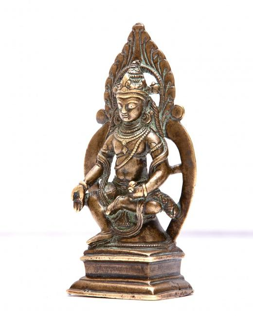 Kashmiri gilt bronze figure of seated Buddha with inlaid silver eyes, possibly 12th century AD, 4 ¼ inches tall (est.  $10,000-$12,000).