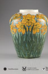 Vase, 1897.  Daffodil design.  Underglaze painting with glossy glaze.  Unknown decorator; Joseph Meyer, potter.  On loan to the Newcomb Art Gallery from Ruth Weinstein Lebovitz