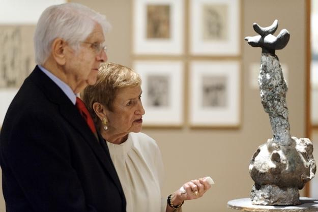 "Donors Jerome and Simona Chazen study ""Monument,"" a sculpture by Spanish artist Joan Miro, on display in a third-floor gallery at the Chazen Museum of Art during a 2011 open house for the museum's expansion."