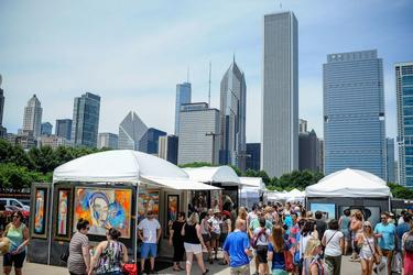 Skyline and crowd at the 2018 Gold Coast Art Fair in Chicago's Grant Park.